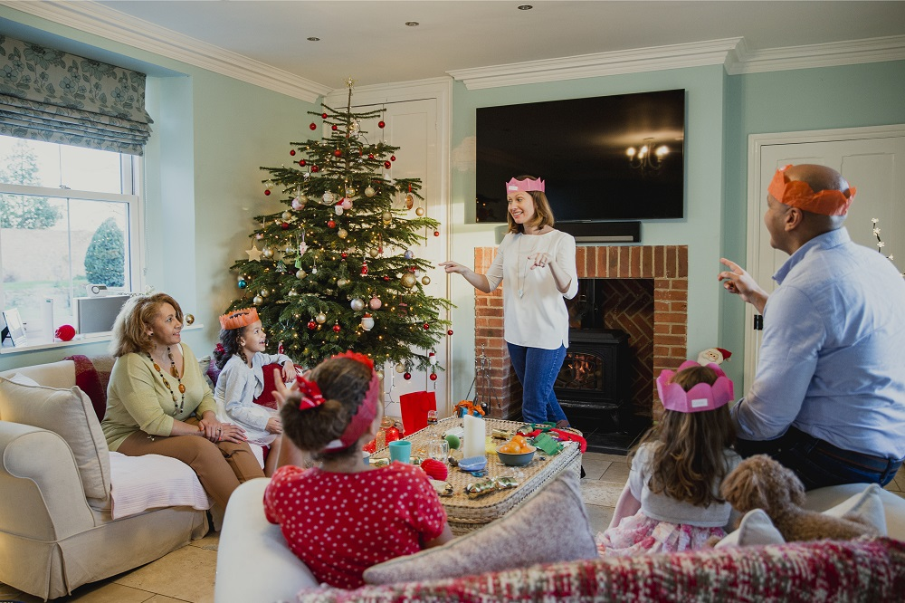 Family playing charades over the holiday season