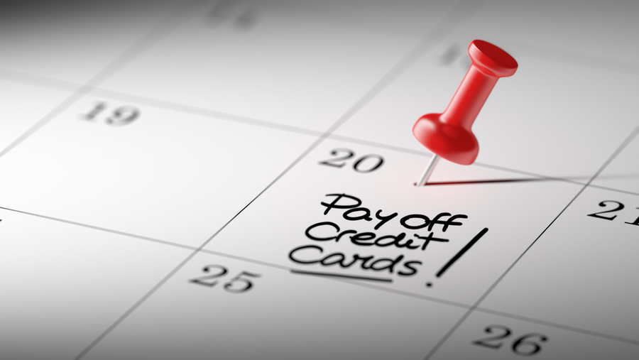 Calendar with pin on 20th saying pay off credit card debt fast!